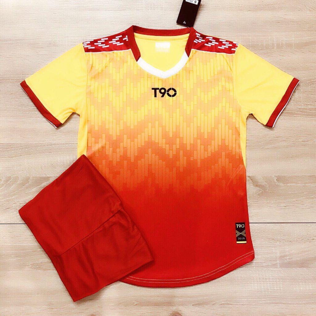 Áo bóng đá không logo T90 màu đỏ vàng năm 2020